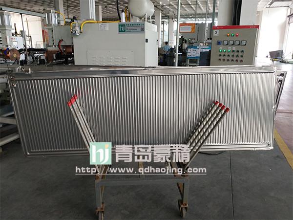 桑乐太阳能安装调试青岛豪精十二头连续缝焊机生产线